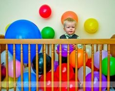 Birthday ball pit-balloons - would change the outfit, but cute idea.
