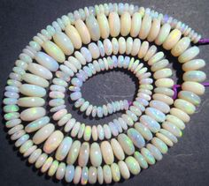 Stunning Australian Opal Bead Strand - gorgeous multicolours :) - in our store now ....