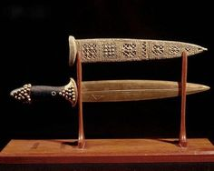 Sumerian Dagger Dated: 2600 - 2400 BC A dagger and sheath from the Royal Cemetery at Ur. Now located in the National Museum of Iraq.