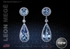 Convertible drop earrings feature natural aquamarines by Leon Mege.