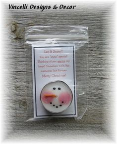 These snowman candles are each made from a tea light candle with a snowman face painted on. Great gifts to pass out to family and friends. Candle comes attached to a card displayed in a protective plastic bag. Card reads,