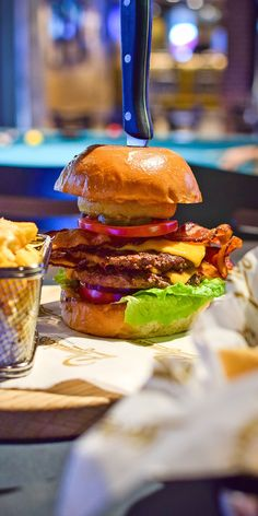 Royal Caribbean Cruise Dining | It's always game on at Playmakers Sports Bar & Arcade. With a menu of game day favorites and icy-cold draughts on tap, anything you order is a winner. Like the signature Playmakers Burger, the buffalo wings, or the four-scoop Touchdown Sundae.