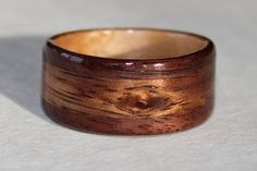 Peter's Black Walnut Wood Ring with Hawaiian Koa Natural knot inlay and Birds Eye Maple interior Liner.