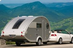 Not really bike related but I really want one...It's a T@B caravan from Germany.