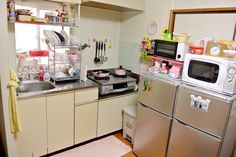 Japanese kitchen. I love the three decker dish rack and the small oven, but I would skip one of the fridges and the pink pots