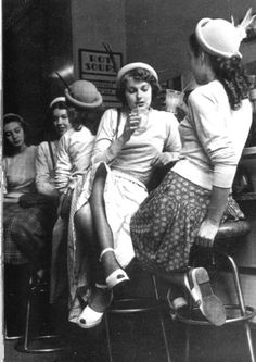 Teenаgers at a soda fountain, 1940s