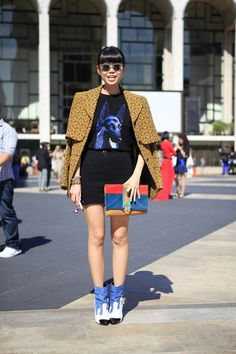 Animal motifs are abound again this season, as seen on the streets of #NYFW. Note the paint-pot boots as well. #streetstyle.  WGSN street shot, New York.