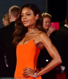Diamonds are a girl's best friend:Naomie was dripping with jewels as she stormed the red carpet, while sporting a stunning string of diamonds on her necklace, while wearing a glimmering, ornate diamond bracelet, ring and studs