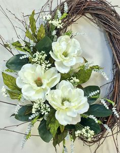 Magnolia Wreath, Spring Wreath, Summer Wreath, Wedding Wreath, Spring Decor, Magnolias, Floral Door Decor, Summer Floral, Green White Welcome in the season with this gorgeous new design from Crooked Tree Creations. Carefully handcrafted on an 18 handmade oval birch base, this stunning floral boasts a trio of beautiful creamy white magnolias. They are surrounded by white wispy trailing fillers and tiny berry clusters. A generous amount of rich greenery complete this stunning floral. This…