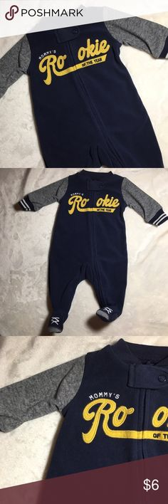 Carter's Newborn Fleece ⚾️ Baseball Footed Sleeper Carter's Newborn Fleece ⚾️ Baseball Footed Sleeper. 'Mommy's Rookie of the Year' navy blue and gray footed sleeper pajamas. Excellent condition! Barely worn! Discount on bundles ⚾️🏈🏀🏉 Carter's One Pieces Footies
