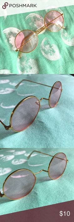🦋 John Lennon Style Sunglasses 🦋 Super cute John Lennon Style sunglasses. Pink lenses with a gold frame. Can be used everyday or for a costume! In excellent used condition.  💥PLEASE NOTE💥 Shipping time can be anywhere from 3-5 business days, however I strive to ship my products between 1-2 days depending on current scheduling and holidays.   Thanks for looking! 😊💕 Accessories Sunglasses