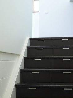 adding storage on staircase - amazing this