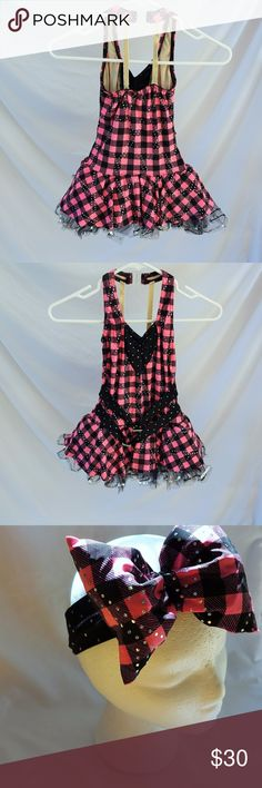 Child Medium Dance or Pageant Costume This sparkle black and pink costume looks great on stage. It comes with a big bow and gloves. We do bundles! :) A wish come true Costumes Dance