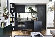Black stained custom kitchen / Jewell Station Display Suite | Clare Cousins Architects