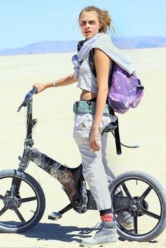 Cara Delevingne wearing Spiral Galaxy Saturn Backpack