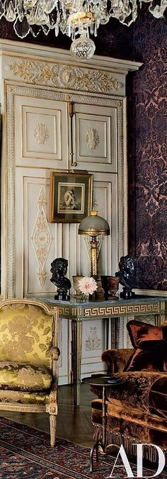 formal, traditional living room. large scale purple damask wall covering, opulent furnishings