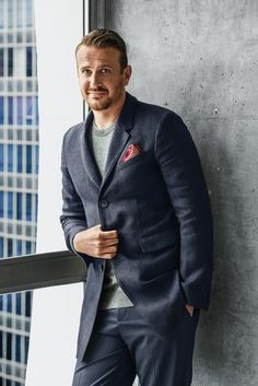 Jason Segel in a Burberry London coat and a Dolce & Gabbana sweater.