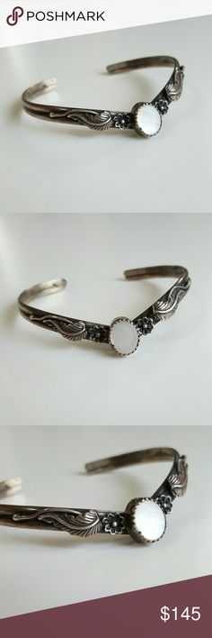 """Native American Cheveron Feather Flower Bangle This lovely silver bracelet was purchased from a Native American stand in Arizona. It is a cheveron shape with detailed feathers and flowers with and oval shaped natural cut and polished iridescent Mother of Pearl in the center. 6.5"""" arround the inside.  One of a kind unique and beautiful bangle that is great with your favorite shirt and jeans. Other great accessories in my closet. Vintage Jewelry Bracelets"""