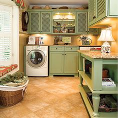 Very unique green cabinets in this mudroom/laundry room. The tile floor brings it all together!