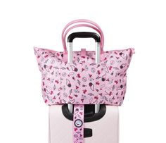 This chic Travel Tote Bag features a Hello Kitty framed embossed silk screen print, polyester twill with faux leather handles and snap closure plus a slip stitched band for over a suitcase handle. This tote can be folded and snapped into place.