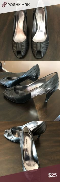 Shoes Gently used black peep toe heels.......the left heel has a small scrape in the leather where my heels got caught in between the concrete in my driveway( barely noticeable once worn).......see picture Etienne Aigner Shoes Heels