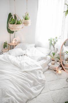 white plant filled bedroom
