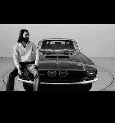 Rock star Jim Morrison from The Doors with his 1967 Night Mist Ford Mustang Shelby that he nicknamed 'The Blue Lady'. Jimmy Morrison, Morrison Hotel, Ray Manzarek, Gainsbourg Birkin, Serge Gainsbourg, The Doors Jim Morrison, The Doors Of Perception, Music Pics, American Poets