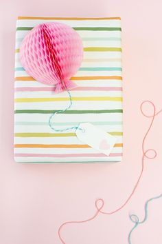 DIY Honeycomb Balloon Gift Toppers - Studio DIY