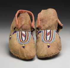 A PAIR OF CROW BEADED HIDE MOCCASINS. . c. 1885. ... (Total: | Lot #77317 | Heritage Auctions
