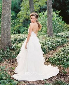 Strapless lace bodice features sweetheart neckline with scalloped eyelash edge, ball gown wedding dress made of quality organza with tiered detail, low back.