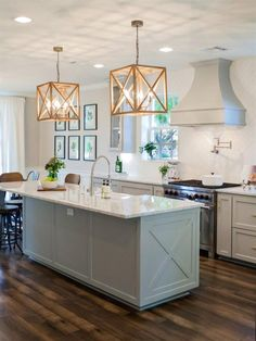 Sage Green Cabinets X Design On Island Vent Hood Cover Pot Filler White Subway Esque Tile Backsplash In The Chevron Capitol Lighting