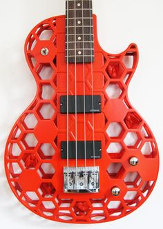 3D printed Hive bass guitar - customize a design.  If I was rich I'd be all over this.