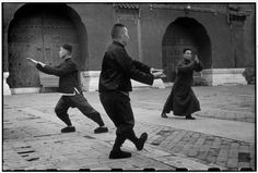 Henri Cartier-Bresson CHINA. Beijing. December 1948 Each morning at dawn these men come to the Tai-miao Gardens to perform ritualistic exercises which serve not only to school the body, but also to discipline the mind to concentrate on matters of the spirit. In this group, there is a bank employee, a conservator of a museum, and an officer of the Kuomintang forces who does his exercises for two hours despite the steady advance of the Communist Army upon the walls of the city.