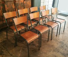 Circa 1960, a set of 8 French Vintage Industrial chairs at standard table-height. These chairs have great character especially the rustic industrial look. Steel base with wood seat and back rest. Chairs have their original green patina finish, the wood panels have been resurfaced, and the metal is finished with a rust-resistant sealer. Show off your industrial chic dining, or on your outdoor patio!  Industrielle Attitude 4763 Eagle Rock Blvd. Los Angeles, CA 90041 323-255-5124