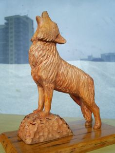 Wolf woodcarving by animal-love