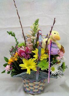 Easter basket full of various flowers