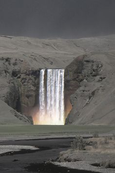 Skógafoss waterfall - Iceland - 2014 - Sverrir Thorolfsson photography - The Skógafoss waterfall amidst a landscape covered in ash spewed from the volcano Eyjafjallajökull in 2010. - - http://www.gettyimages.com/detail/photo/skgafoss-royalty-free-image/168336889
