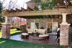 Traditional Porch with exterior stone floors, French doors, 10x10 Traditional Wood Pergola, Fence, exterior tile floors