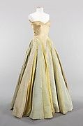 <p>Alternating sections of supple gleaming charmeuse, crisp shimmering taffeta, and stiff matte faille determine the shape, movement, and visual appeal of this ball gown. Elaborating on the concept of his early garments constructed from antique silk ribbons, James used lengths of fabric to construct the skirt of this dress