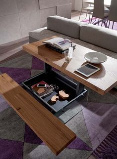 The Picnic Bellagio transforming coffee table features a top that can be raised higher to serve multiple functions, hidden storage, and a built-in seat.