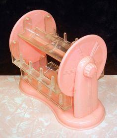 Vintage 1950s pink plastic rotating thread holder on Etsy, $40.00