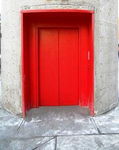 Red Door to a circular elevator shaft