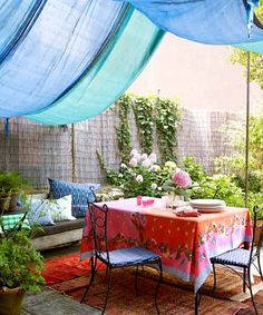 One of the simplest ways to enclose a space is with fabric. Here, long lengths of silk hang over a clothesline strung between the house and a pole anchored in the backyard. Secure the sides to a fence or a roof overhang with sturdy spring clips.   Photo: Debi Treloar   thisoldhouse.com