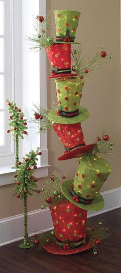 Christmas decorating with hats in traditional Christmas colors, how neat! I have to try this for Christmas 2015.
