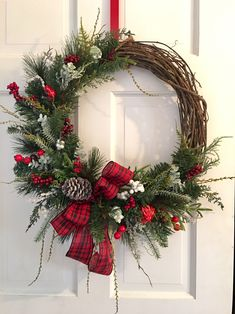 What a beautiful way to add Christmas to your home. This beautiful custom wreath is full of greenery, berries and a bold plaid bow. Christmas Wreaths For Front Door, Christmas Door Decorations, Christmas Wreaths To Make, Holiday Wreaths, Christmas Crafts, Thanksgiving Wreaths, Thanksgiving 2020, Winter Wreaths, Spring Wreaths