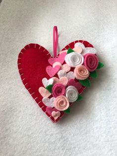 A personal favorite from my Etsy shop https://www.etsy.com/listing/593119267/valentines-felt-heart-ornament