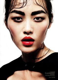 Liu Wen in a cherry lip and the boldest of brows in Vogue China
