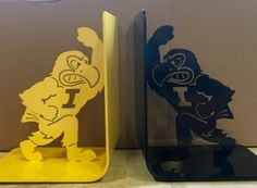 Herky bookends! Powder coated in black and Hawkeye gold.  Great for the bookshelf of any Hawkeye fan.  Order yours today at https://msplaser.com/