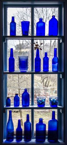 Cobalt Blue Bottles Window Display // So Pretty When The Sun Shines In :0)