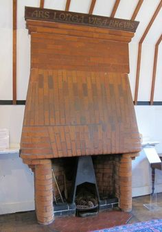 """Red House: William Morris' living room fireplace with the motto: """"Ars Longa, Vita Brevis"""": """"Art is long, Life is short."""" #William_Morris #Red_House #Arts_and_Crafts"""